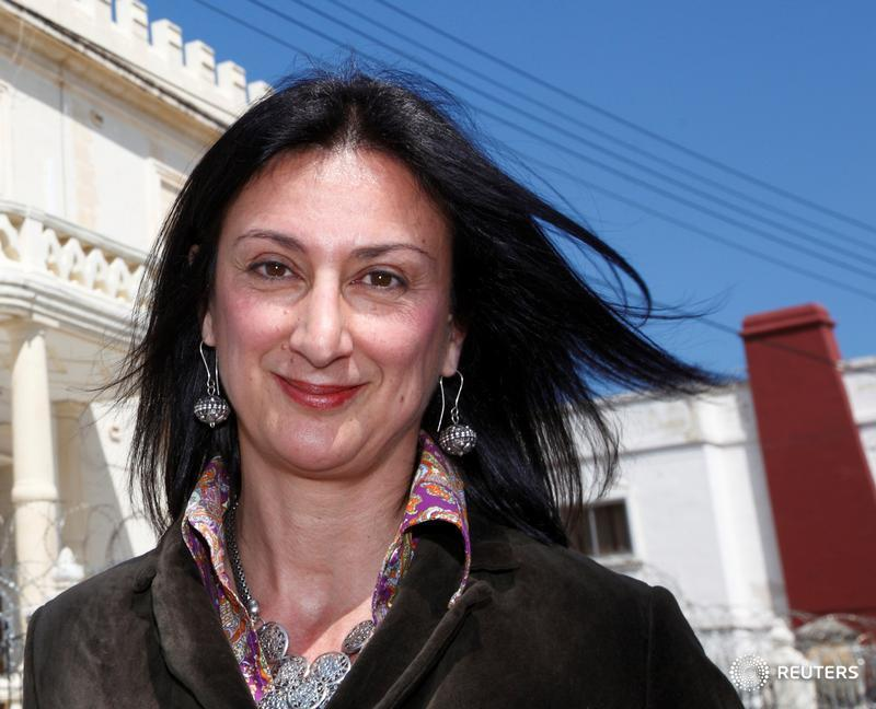 Maltese investigative journalist Daphne Caruana Galizia poses outside the Libyan Embassy in Balzan